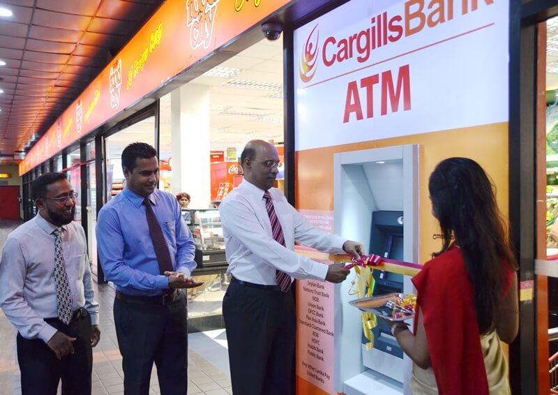 Cargills Bank Managing Director / CEO Mr. Prabhu Mathavan declaring the Majestic City Off-site ATM open, along with DGM Consumer Banking - Mr. Lewie Diasz and Mr. Rumaiz Rahim - DGM Marketing.